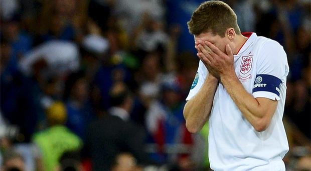 England captain Steven Gerrard looks dejected after being knocked out of Euro 2012 by Italy on penalties. Photo: Reuters