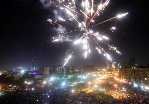 Fireworks explode as supporters of Muslim Brotherhood's president-elect Mohamed Morsi celebrate his victory. Photo: Reuters