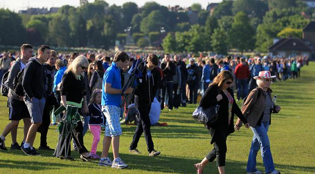 Thousands of people line up in the queue outside for the start of day one of the 2012 Wimbledon Championships. Photo: PA