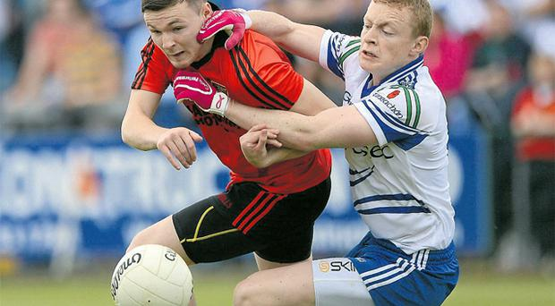 Monaghan's Colin Walshe tries to get to grips with Donal O'Haire at the Athletic Grounds