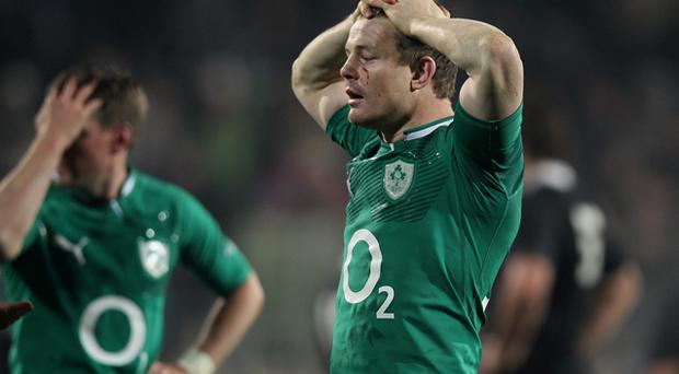 Brian O'Driscoll cuts a dejected figure after the game