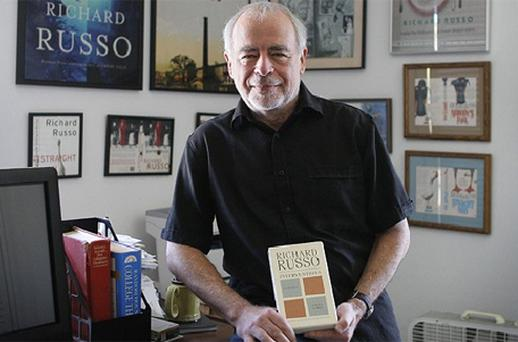 Richard Russo with his newest work, 'Interventions,' in his home in Camden, Maine. A critic of e-books, Russo won't allow Interventions to be sold in electronic form. Photo: AP