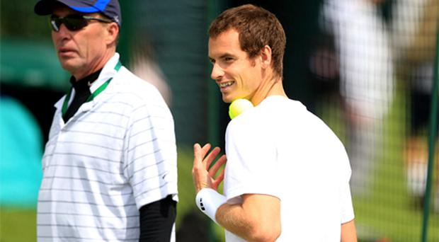 Andy Murray is watched by coach Ivan Lendl during day one of the 2012 Wimbledon Championships. Photo: PA