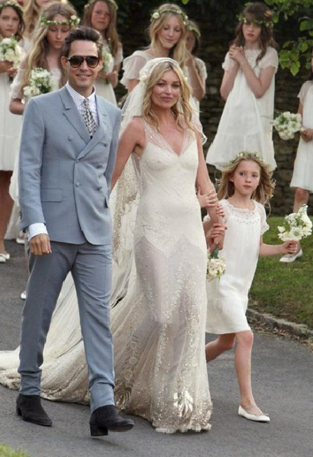 Lila Moss with mum and step-dad Jamie Hince at their wedding last July