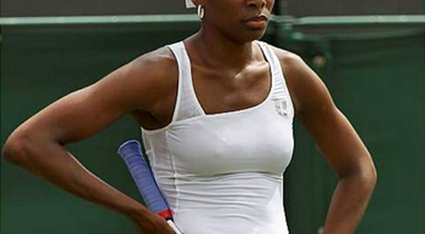 A dejected Venus Williams after her defeat at Wimbledon yesterday