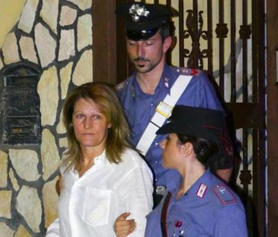 Raffaella D'Alterio (C), who became head of the Camorra clan Pianese-D'Alterio after the murder of her husband, is arrested by police in Castello di Cisterna, Naples