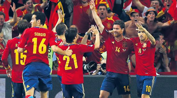 Spain's players celebrate Xabi Alonso's opening goal against France on Saturday