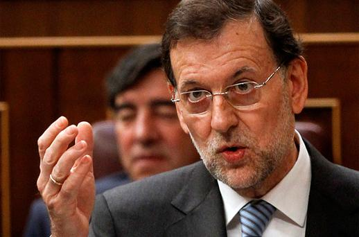Spain's Prime Minister Mariano Rajoy answers a question during a parliamentary session. Photo: Reuters