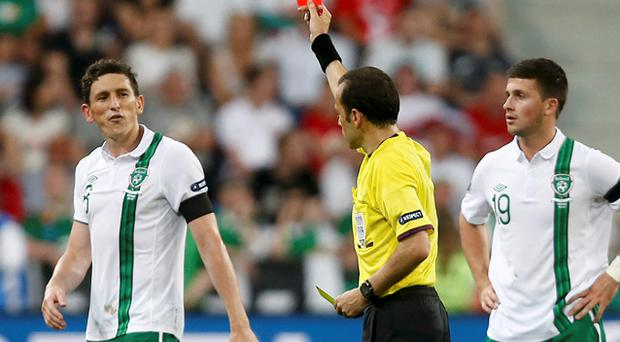 Referee Cuneyt Cakir shows a red card to Keith Andrews during Ireland's Euro 2012 clash with Italy. Photo: Reuters