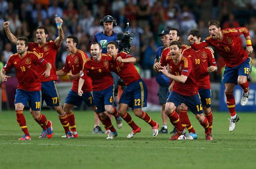 Spain's players celebrate after defeating Portugal after Euro 2012 semi-final. Photo: Reuters