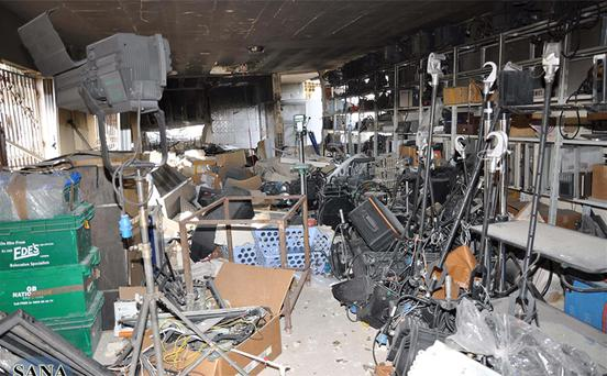 Damaged buildings are seen after gunmen stormed the headquarters of Al-Ikhbariya news channel near Damascus. Photo: Reuters