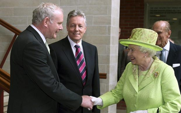 June 27, 2012: Queen Elizabeth shakes hands with Northern Ireland deputy first minister Martin McGuinness at the Lyric Theatre in Belfast, Northern Ireland. Photo: Reuters