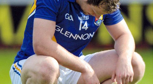 Longford's Brian Kavanagh shows his disappointment after his team's defeat to Wexford in the Leinster championship and they face Derry in the first round of the Qualifiers this weekend