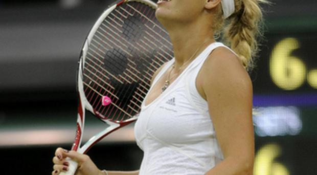 Caroline Wozniacki shows her disappointment at losing at Wimbledon