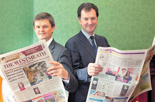 At the announcement of the Irish management team's acquisition of the business and assets of Celtic Media Group, publishers of the Anglo-Celt and Meath Chronicle, were (left) Frank Long, finance director, and (right) Frank Mulrennan, chief executive