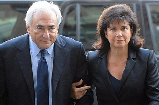 Dominique Strauss-Kahn (C) , the former director of the IMF, and his wife Anne Sinclair