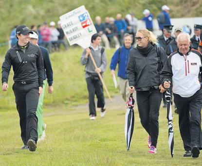 Rory McIlroy with girlfriend Caroline Wozniacki and father Gerry on the seventh fairway during the 2012 Irish Open Golf Championship at Royal Portrush, Co Antrim, yesterday