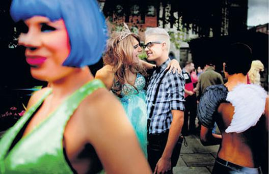 OUT AND ABOUT: Revellers make the most of a break in the weather at yesterday's Dublin Pride parade. Photo: David Conachy