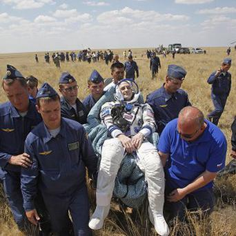 Russian space agency rescue team carry US astronaut Donald Pettit shortly after the landing of the Russian Soyuz space capsule (AP)