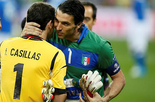 Goalkeepers Gianluigi Buffon and Iker Casilas exchange words ahead of kick-off