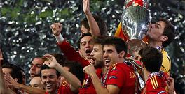 Spain's Iker Casillas kisses the trophy after defeating Italy to win Euro 2012
