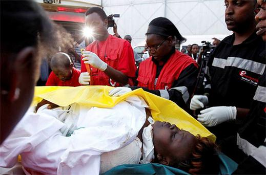 Paramedics from Kenya Red Cross attend to a woman wounded during an attack on churches in Kenya's northern town of Garissa, at Wilson airport in Nairobi. Photo: Reuters