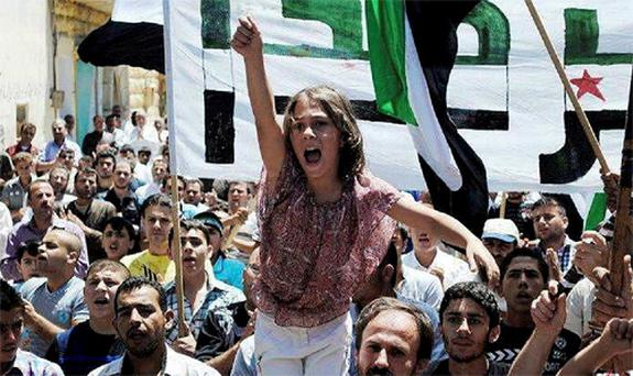 A Syrian girl chants slogans during a demonstration in Idlib, north Syria. Photo: AP