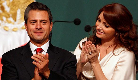 Enrique Pena Nieto next to his wife Angelica Rivera