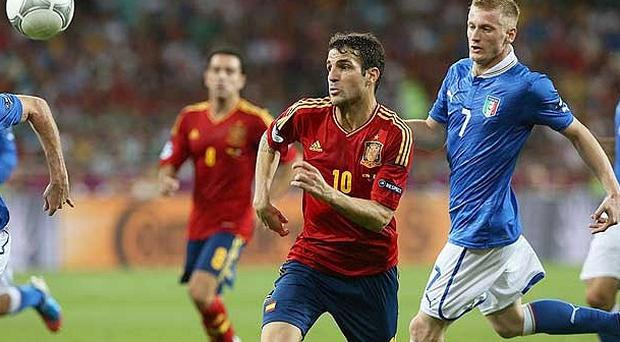 In total control: Cesc Fabregas helped lead the Spanish attack
