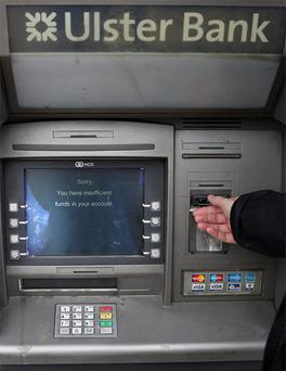 A customer tries to with cash at Ulster Bank on Dorset street, Dublin. Payments into and out of Ulster Bank accounts have been disrupted since last week. Photo: Fran Veale