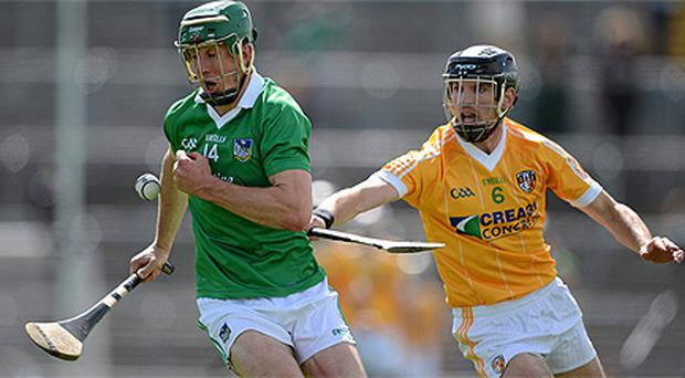Limerick's Niall Moran, left, in action against Michael Herron, Antrim