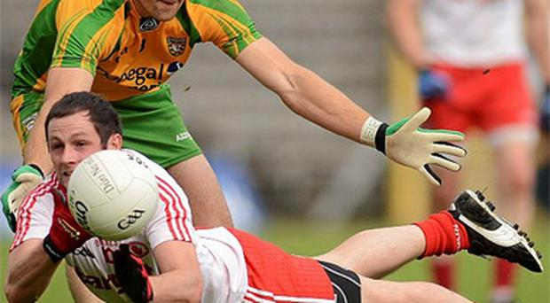 Ronan McNabb, Tyrone, in action against Ryan Bradley, Donegal. Ulster GAA Football Senior Championship Semi-Final, Tyrone v Donegal, St Tiernach's Park, Clones, Co. Monaghan. Photo: Sportsfile