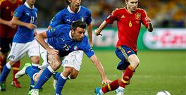 Andreas Iniesta leaves Italy's Andrea Barzagli and Andrea Pirlo trailing in his wake in the Euro 2012 final