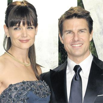 Katie Holmes and Tom Cruise at a party in Hollywood last February. The couple are divorcing after five years of marriage