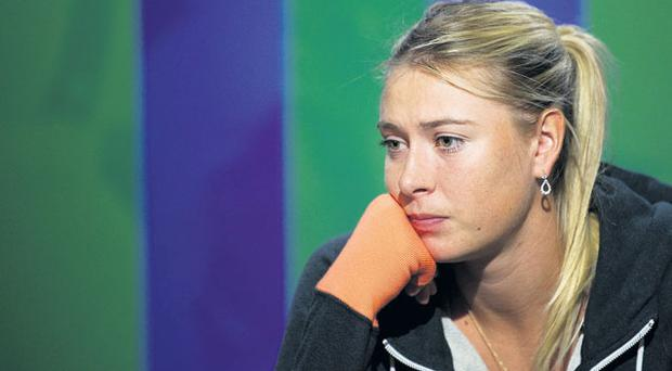 Maria Sharapova cut a disappointed figure in the post-match press conference after being knocked out of the Wimbledon championships yesterday