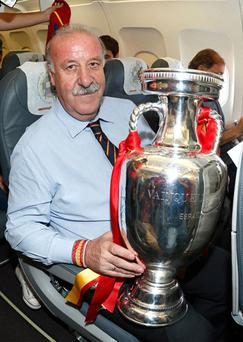Head Coach Vicente del Bosque of Spain poses with the trophy following his team's victory