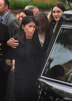 Partner of Eugene Moloney Chichi Tran & Sister of Eugene Moloney Rosin Moloney at the funeral of Eugene Moloney at Our Lady Queen of Peace Church Merrion Road, Dublin. Photo: Collins
