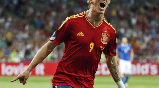 Spain's Fernando Torres celebrates scoring his side's third goal during the Euro 2012 soccer championship final between Spain and Italy in Kiev, Ukraine, Sunday, July 1, 2012. (AP Photo/Matthias Schrader)