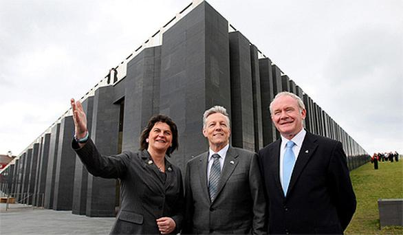 Northern Ireland Tourism Minister Arlene Foster joins First Peter Robinson (centre) and Deputy First Minister Martin McGuinness outside the new £18.5m the Giant's Causeway visitors' centre
