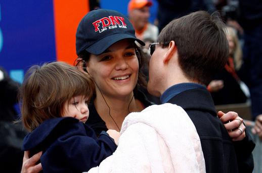 Katie Holmes with Tom Cruise and their daughter Suri
