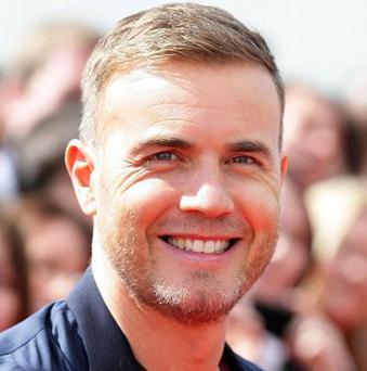 An MP has poked fun at Gary Barlow over allegations about his tax affairs