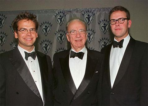 Lachlan Murdoch (left) with Rupert and James Murdoch, in 1998 -