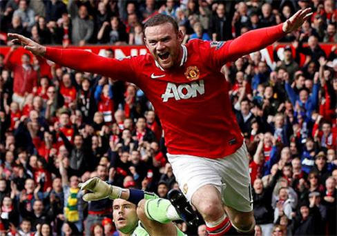 Manchester United's Wayne Rooney celebrates after his goal during their English Premier League soccer match against West Bromwich Albion at Old Trafford in Manchester. Photo: Reuters