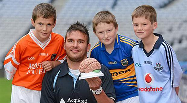 At the launch of the Concussion Awareness Video Campaign yesterday were, from left, Eoghan Quinn, age 9, Armagh, former Fermanagh footballer Mark McGovern, Sean O'Connell, age 9, Tipperary and Mark Bailey, age 9, Dublin