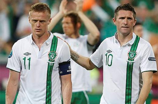 Damien Duff and Robbie Keane leave the pitch after defeat against Italy at Euro 2012. Photo: Reuters
