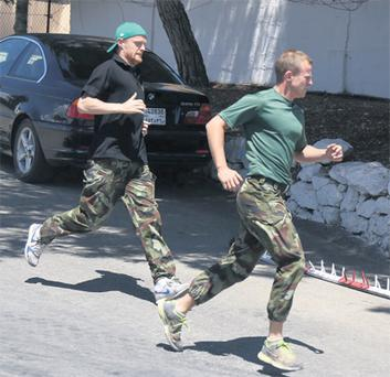Damien Duff and Private Sean Montgomery take part in an army endurance test during Duff's visit to the Lebanon yesterday