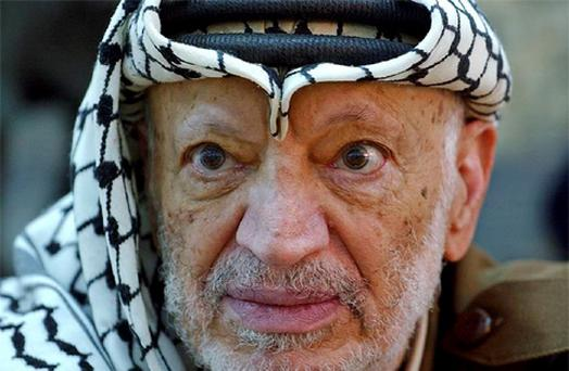 Palestinian leader Yasser Arafat pauses during an emergency cabinet session, at his compound, in the West Bank town of Ramallah. Photo: AP