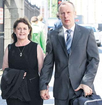 Dana Doherty and her partner, Fintan Gallagher, leaving the High Court. Photo: COLLINS
