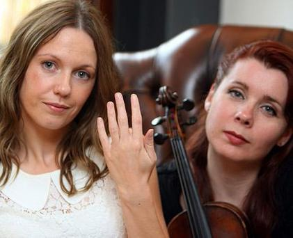 Ashling Cahill, who lost her engagement rings after her friend Imogen Gunner (right) flushed them down the toilet.