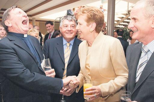 Former President Mary McAleese sported a new hairdo at the Tipperary International Peace Prize award ceremony yesterday, where she shared a joke with Fr Brian D'Arcy and Tipperary hurling legend Babs Keating and her husband Martin.